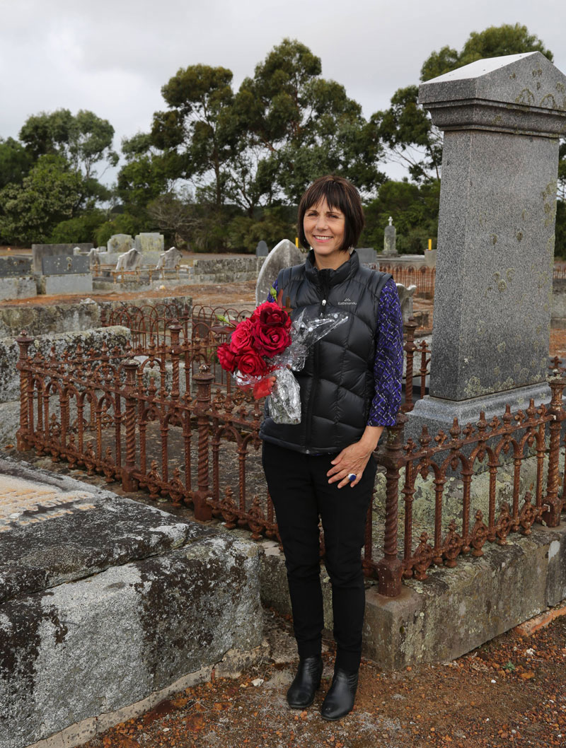 event organiser Maryanne Martin visits the grave of David Millard, Condah cemetery, to place flowers. Millard was gassed during the war but just managed to get home and died in October 1918.
